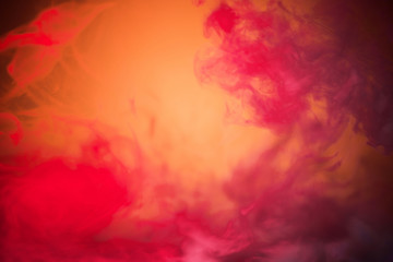 colorful red smoke on yellow background