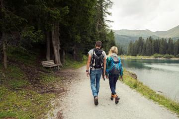 Rear view of couple hiking by lake, Tirol, Steiermark, Austria, Europe