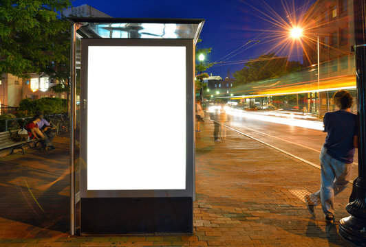 Bus Shelter Billboard and City Lights