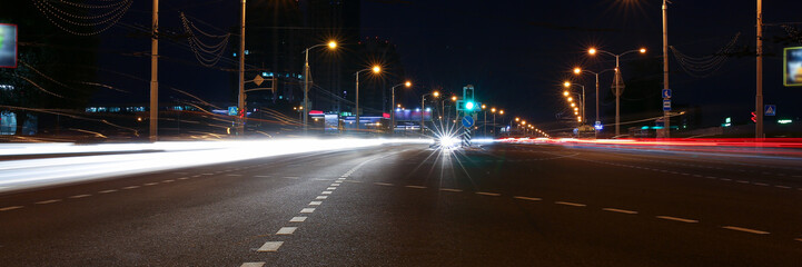 Landscape of the city of Minsk in Minsk Belarus blurred lights of car headlamps in the motion of the window vsetsya in the evening