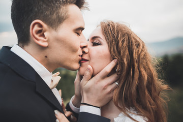 Sensual portrait of a young wedding couple. Outdoor