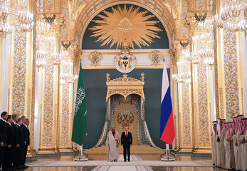 Russian President Vladimir Putin and Saudi Arabia's King Salman attend a welcoming ceremony ahead of their talks at the Kremlin in Moscow