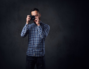A man taking pictures with a compact camera.