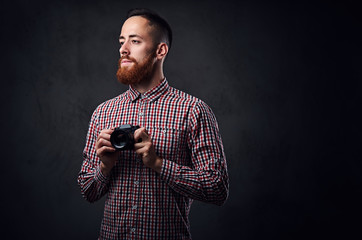 Redhead male taking pictures with a compact camera.