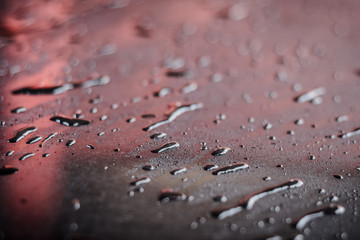 Rain drop on car hood. small depth of field