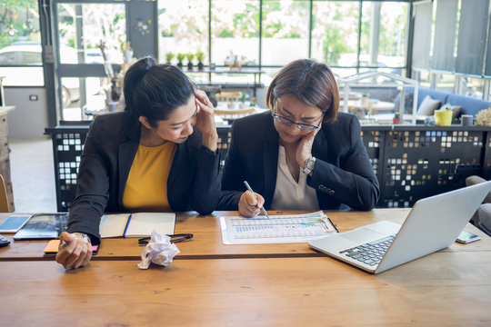 Business women are feeling stressed while working hard in their work.