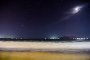 Sea at night with moon illuminating