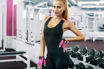 Portrait of woman in gym looking at camera posing