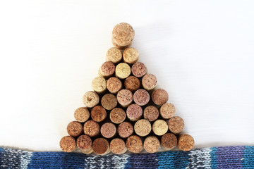 winter vacation finale/ installation of a Christmas tree of wine cork on a blue scarf