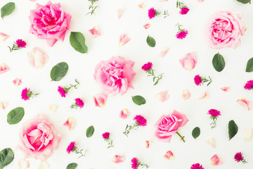 Pattern with pink flowers, petals and leaves on white background. Flat lay, top view. Roses background