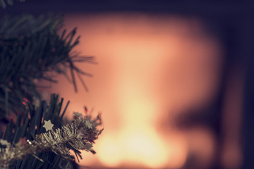 Glowing Christmas background with copy space and focus to small golden stars