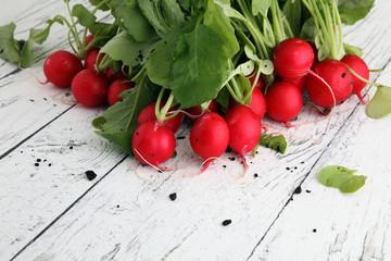 Radish. Red fresh radish. Fresh Vegetable on white table.