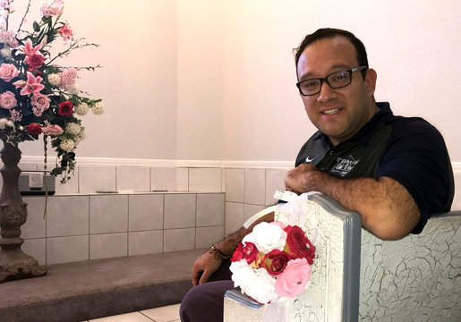 A Little White Wedding Chapel owner Salas, sits in his chapel in Las Vegas