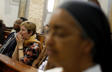 People pray during a prayer vigil for the victims of Las Vegas' shooting, in Rome
