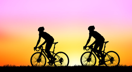 Silhouette group  bike relaxing on blurry sunrise background