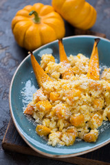 Risotto with pumpkin and parmesan, close-up, selective focus, vertical shot