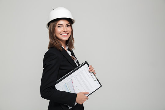 Portrait of a happy smiling woman in hard hat