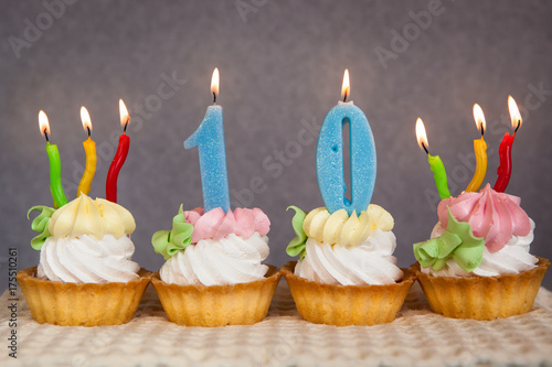 Happy 10 Birthday Cakes And Blue Numbers Candles Stock Photo And