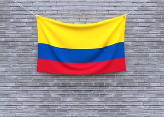 Colombia flag hanging on brick wall. 3D illustration