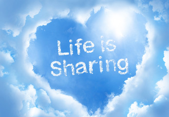 Life is shareing ,cloud word inside heart cloud frame on blue sky background..