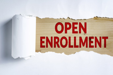 Torn paper with OPEN ENROLLMENT in opening background
