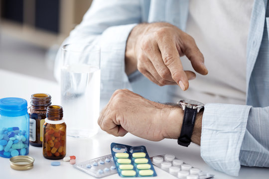 Time to take pills for old man