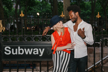 Multi-ethnic Couple in a Subway Entrance in Manhattan, New York