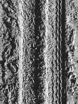 Close up of tire tracks on beach