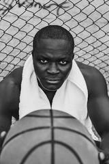 Young Black Man Holding a Basketball Ball