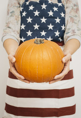 Halloween. Making a jack-o-lantern