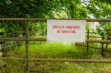"Sign on a farm gate ""Private Property - No Shooting"""