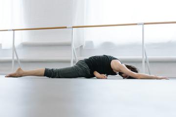 Male Ballet Dancer at dance studio training hall