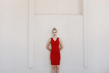 Blonde girl in a red dress