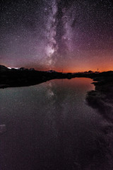 Mountain lake with galaxy