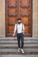Tough Italian Man in front of an Old Wooden Door