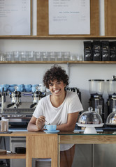 Portrait of beautiful young cofee shop worker