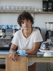 Portrait of beautiful young cofee shop owner
