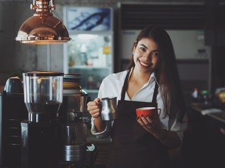 Asian woman working in coffee shop cafe