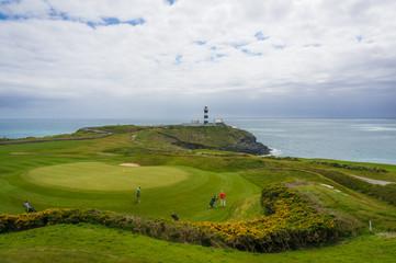 Golfers at 18th green, Old Head Golf Club in Kinsale, County Cork