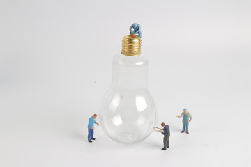 worker character as electrician with bulb