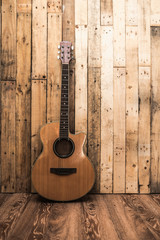 acoutic guitar on vintage wood background with copy space.