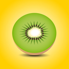Slices of kiwi fruit on a yellow background