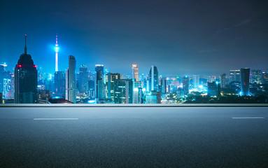 Fotomurales - Side view asphalt road on snight scene near the modern city .