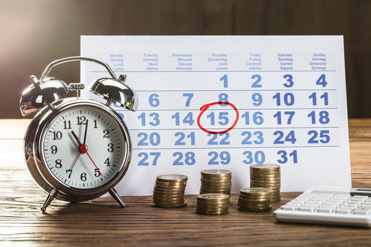 Tax Time On Alarm Clock With Coins