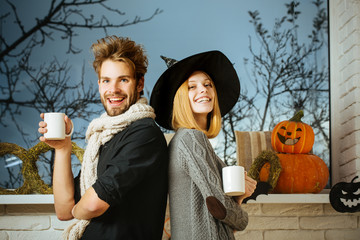 Halloween couple in love smiling at window