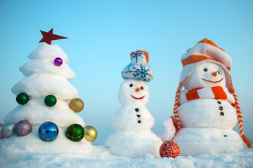 Snowmen on blue sky background