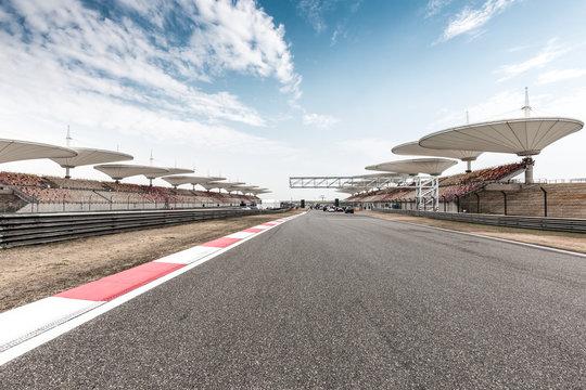 empty asphalt road  in car racing track