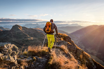 Mountaineer hiking in the mountains in morning light