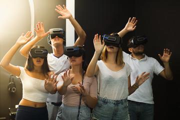 People wearing virtual reality goggles