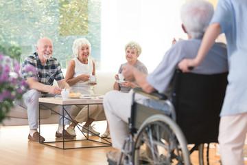 Seniors visiting their friend